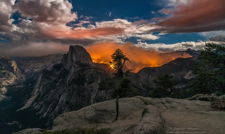 A wide angle shot of the Yosemite wildfire that broke out on Sunday morning and burned throughout the night.  The light from the moon, the fire and even the stars made this shot for me.    Looking through the viewfinder the scene was surreal and epic at the same time.  Destruction of some of the best and most popular trails in Yosemite.  Clouds continued to move in and I saw lighting to the right out of frame.  It did rain some and I am sure that helped suppress the fire that continued to smolder.   Soon  the glow of the flames turned to a smoky misty shroud around half dome.    This is one of the more impressive shots I have gotten in a while and I came away with dozens that are equally impressive.  It was hard to choose which ones.